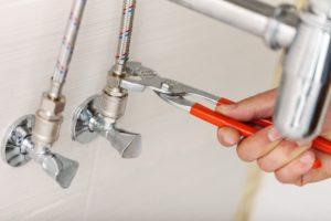 fixing leaking pipe