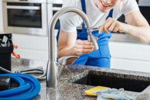 plumber fixing sink faucet